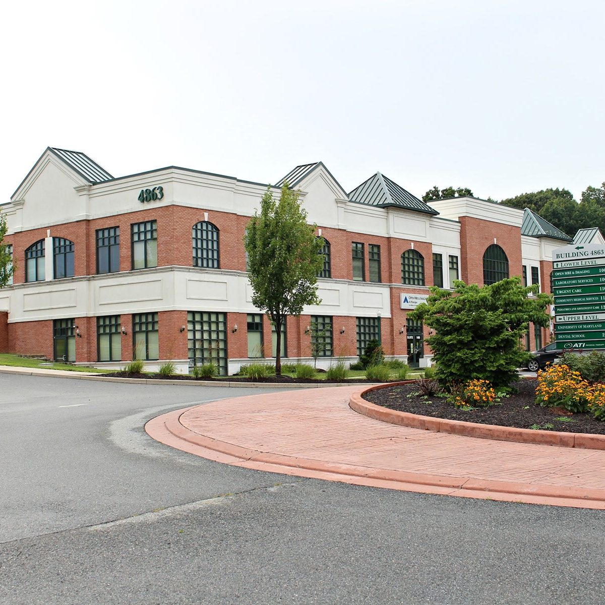 commercial building complex with flower bed